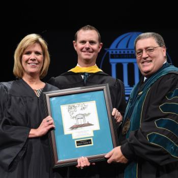 From left: Director of Alumni Relations Jean Ann Brakefield '84, Alumnus of the Year Brian Forbus '97 and CCU President David A. DeCenzo at the 2015 Founders Day Convocation