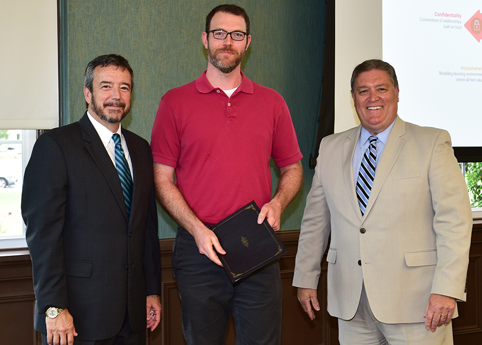Mitchell Church receives his certificate from Dr. DeCenzo and Dr. Byington