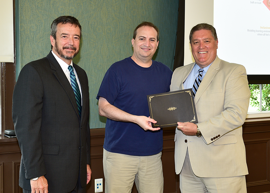 Dennis Edwards receives his certificate from Dr. DeCenzo and Dr. Byington