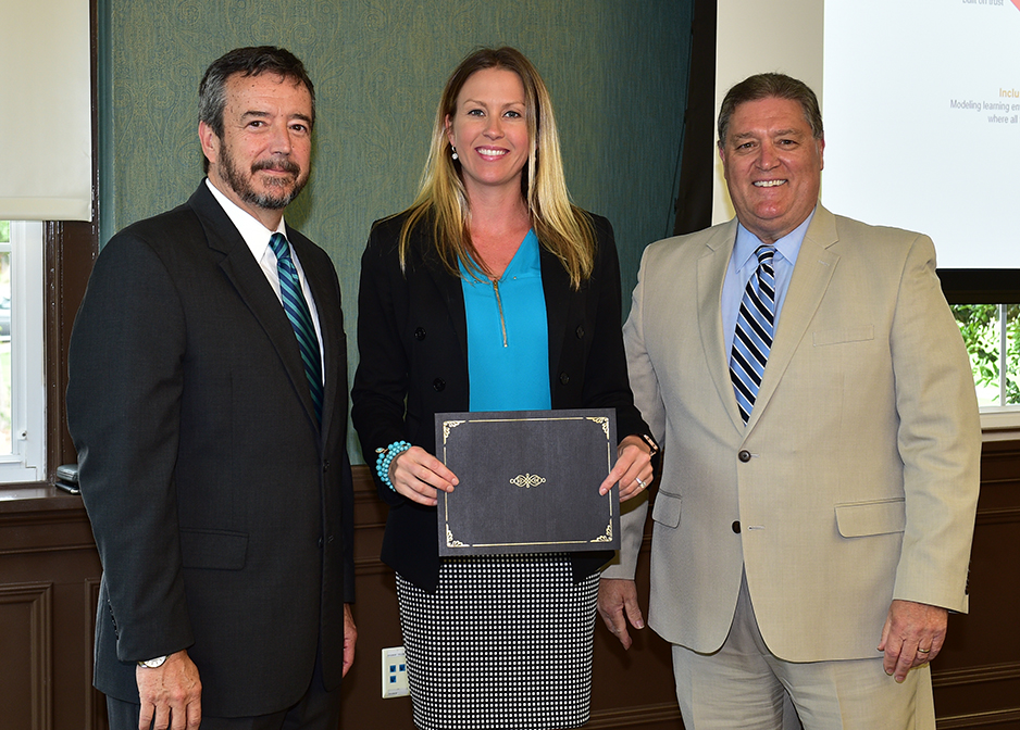 Monica Fine receives her certificate from Dr. DeCenzo and Dr. Byington
