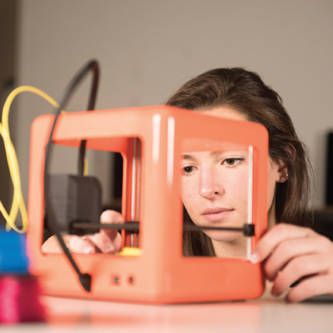 Taylor Pascale at work with a 3-D printer.