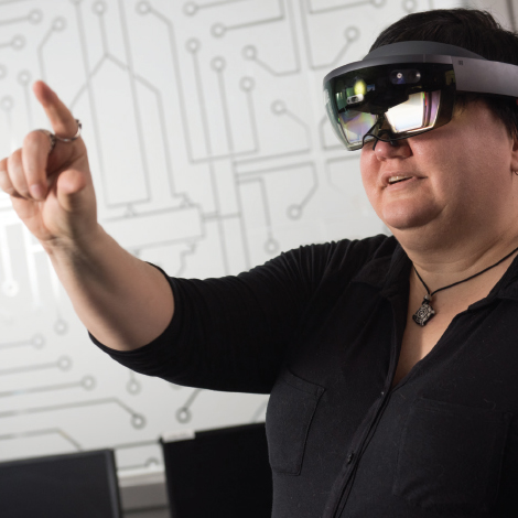Professor Sue Bergeron demonstrates the mixed reality device