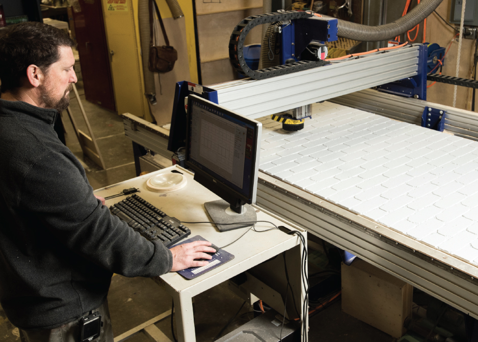 Roboprinter: Gregg Buck programs the CNC robot to make a brick wall for a CCU theater production.