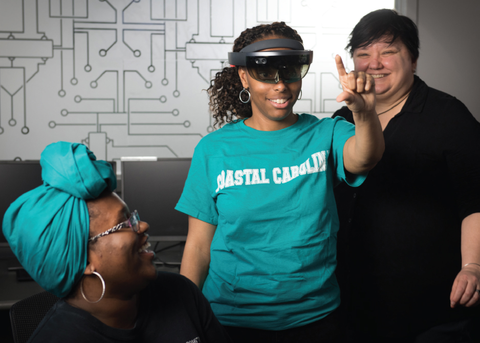 Mixing realities: CCU student Leslie Benning (center) manipulates a holographic image produced by the Microsoft HoloLens, with fellow student 