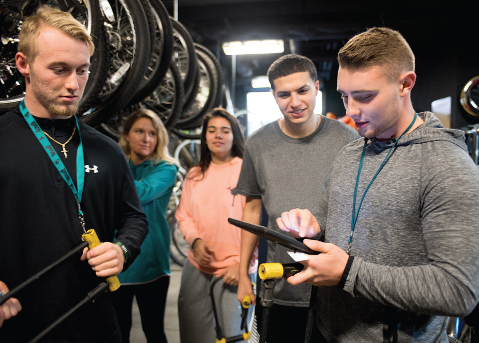 Pedal Power: At the beginning of each semester, students choose from Coastal Cycles' 600-bike inventory. (below) Students must watch a safety video and complete a survey before being issued a bike.