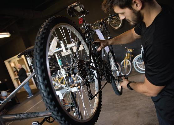 Pit stop: Bike tech supervisor Brandon Cassarino makes sure the cycles are road ready.