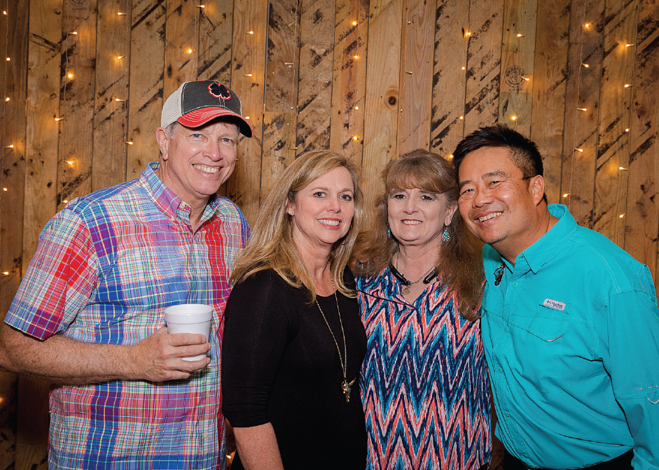 Robert '78 and Renee Smith, Renee and Lex Gardner at the third annual Boots and Bronze CCU alumni event.