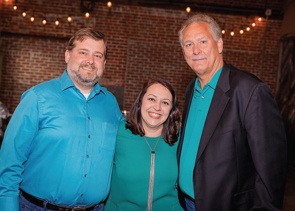 Brian Bunton, Kayla Johnson '06, Stan Parker '83 at the third annual Boots and Bronze CCU alumni event.