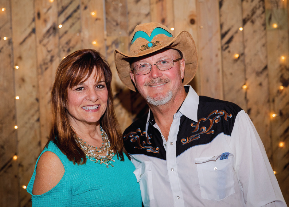 Ronda and Scott DeHollander at the third annual Boots and Bronze CCU alumni event.