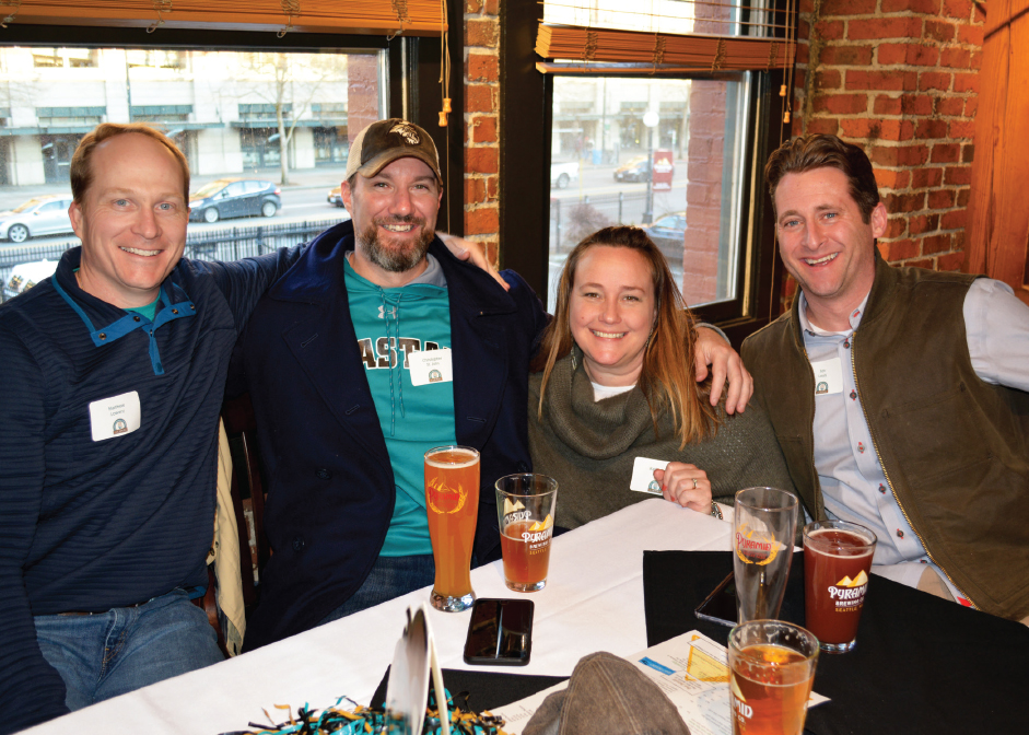 Rad Lowery '00, Christopher St. John '01, '09, Katie '00 and Jon Louis Robert Wingate, David Sage '85, Wren McMeekin '07, Chris Johnson enjoying the CCU alumni gathering in Seattle.