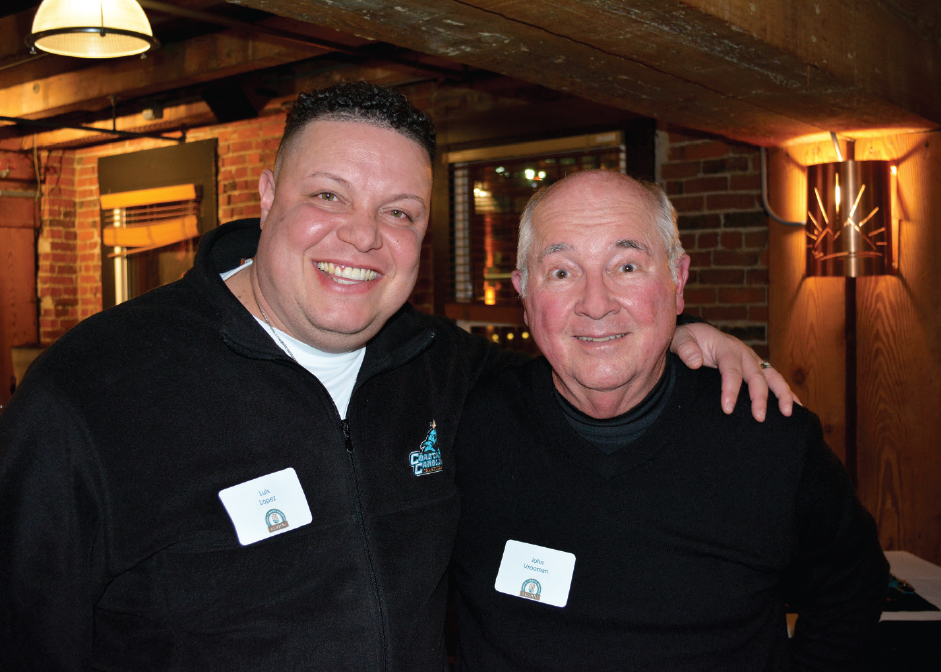 Luis Lopez '94, John Vrooman enjoying the CCU alumni gathering in Seattle.