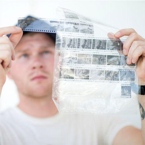 Photography Student with film negatives in the photography studio.
