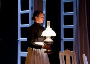 Woman with lantern, Theatre production of Hedda
