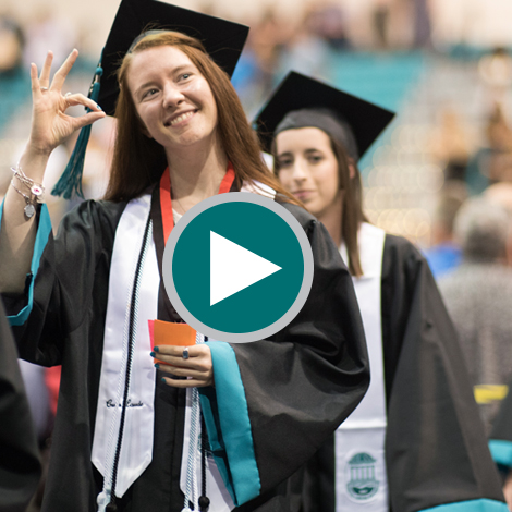 A CCU student walking up to hear her name called at Commencement.