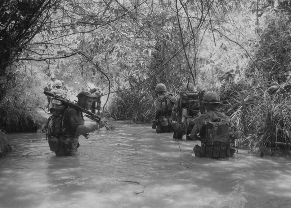 U.S. Marines of Compnay H, 2nd Battalion Regiment take to the water image, National Archives image