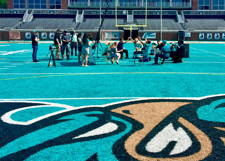 At CCU football field doing a video commercial for CCU communication