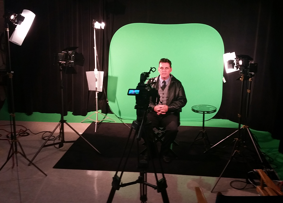 Timmy Winningham set up lighting in the CCU video studio