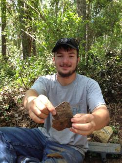 Photograph of CCU history major and anthropology minor Justin Kiser at the May 2015 Field School.