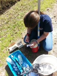 Rachel Trimble performing water quality monitoring as part of her QEP experience in Spring 2014