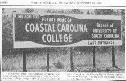 1961 news photo billboard announcing future campus
