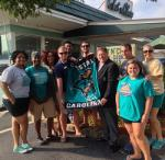 CHANT411 students, President present CCU flag ChatnChew July2014