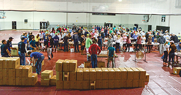 Image of more than 550 students from CCU's Greek community packaging meals for the hungry