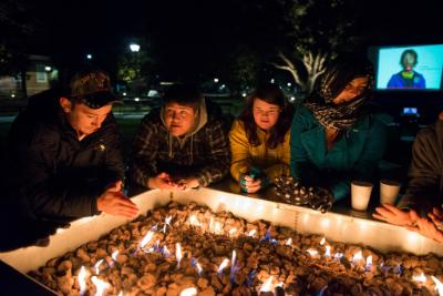 Coastal Carolina students stand around fire pit to keep warm at the Homeless Sleep Out