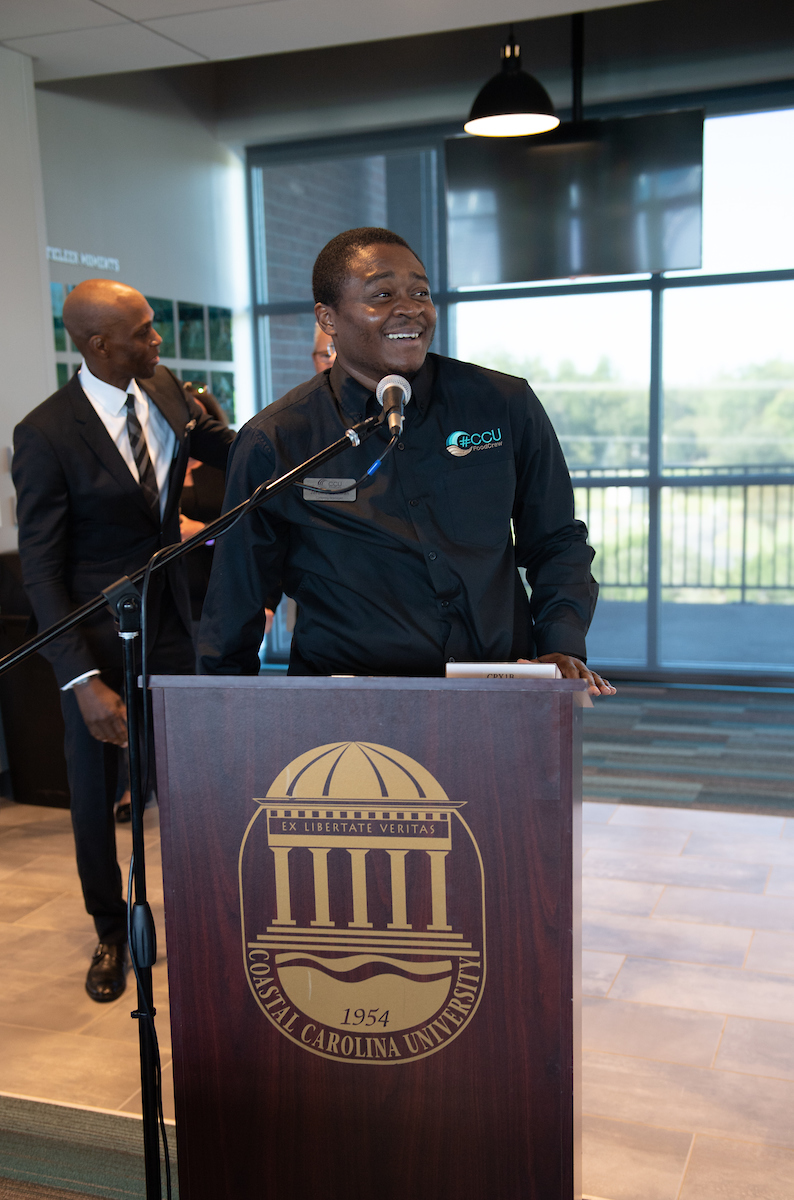 Jerome Coleman is the inaugural recipient of the Presidential Feel the Teal Award, given to him during a board of trustees meeting in October.